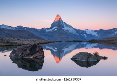 The famous Matterhorn reflected in the Stellisee during dawn. Zermatt, Switzerland.