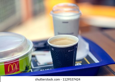 Famous McDonald's restaurant, Poland - Nowy Sacz - July 4, 2018. Set of food on a tray at a Mcdonalds restaurant. Salad, shake and coffee. Shallow depth of field.