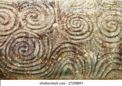 Famous megalithic triple spiral on the entrance stone at Newgrange, World Heritage Site.