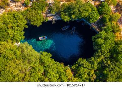 Famous Melissani lake on Kefalonia island, Karavomylos, Greece. On top of Melissani Cave (Melissani Lake) in Karavomylos village in Kefalonia island , Greece. Melissani Cave viewed from above.