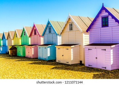 Famous Mersea Island Beach Huts in west Mersey, beautiful sand filled beaches on a summers day