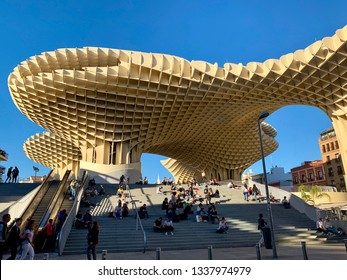 Famous Metropol Parasol modern building on February 2019 in Seville, Spain. View of Metropol Parasol in downtown of Seville and tourists on the stairs.