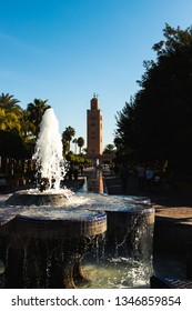 The famous minaret of Koutoubia Mosque as seen from a fountain in Parc Lalla Hasna during a spring morning (Marrakesh, Morocco, Africa)