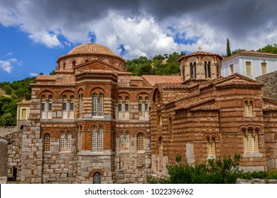 The famous monastery of Hosios Loukas, a historic walled monastery in Greece, part of the list of UNESCO's World Heritage Sites. It is a masterpiece of middle byzantine architecture and art. - Shutterstock ID 1022396962