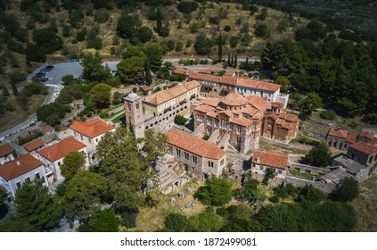 The famous monastery of Hosios Loukas, a historic walled monastery in Greece, part of the list of UNESCO's World Heritage Sites. It is a masterpiece of middle byzantine architecture and art. - Shutterstock ID 1872499081