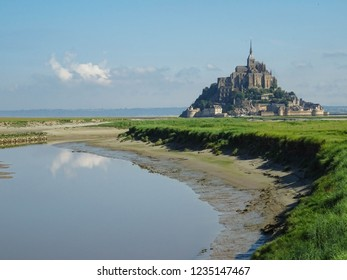 famous Mont Saint-Michel Monastery, popular landmark in Normandy located on tidal island in northern France, medieval monastery has good fortification and was never conquered