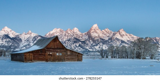 the famous moulton barn on mormon row in grand teton national park in winter alpenglow.