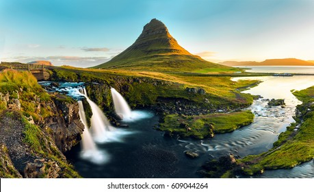 The famous mountain Kirkjufell and its waterfalls are pictured in a panoramic long exposure during a sunset on the Snaefellsness Peninsula near the North East Coast of Iceland