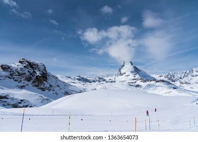 The famous mountain Matterhorn peak with cloudy and blue sky from Gornergrat, Zermatt, Switzerland