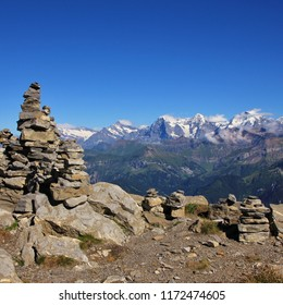 Famous mountain range Eiger, Monch and Jungfrau. Eiger North Face. Cairn on the summit of Mount Niesen. Bernese Oberland, Switzerland.