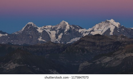 Famous mountain range Eiger, Monch and Jungfrau after sunset.