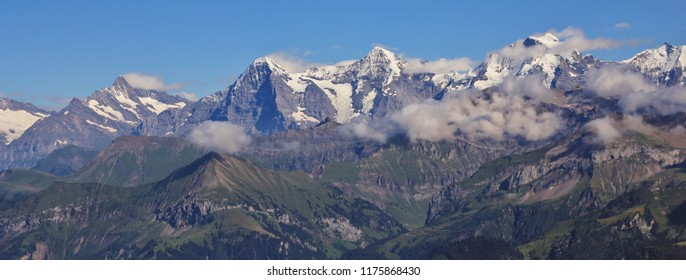 Famous mountains Eiger, Monch and Jungfrau seen from Mount Niesen, Switzerland.