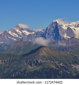 Famous mountains Eiger and Monch. Eiger North Face. View from Mount Niesen. Bernese Oberland, Switzerland.