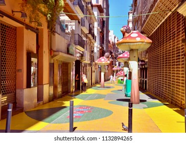 Famous mushroom street in Alicante city, street art on the Calle de las Setas. Tourist attraction and shopping avenue, Alicante, Spain. Europe July 2018