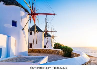 Famous Mykonos town windmills in a romantic sunset, Mykonos island, Cyclades, Greece