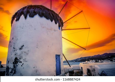 Famous Mykonos town windmills in a sunrise at  early Morning, Mykonos island, Greece/ Colorful sky.