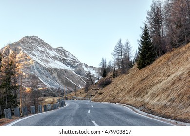 Famous narrow winding alpine road in Austrian Alps - Grossglockner, that runs through the mountains, natural winter background