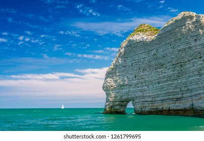Famous natural cliffs in Etretat. Etretat is a commune in Seine-Maritime department in Haute-Normandie region in France. Etretat is now a famous French seaside resort