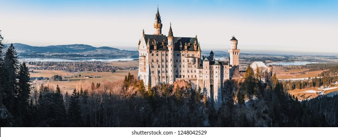 The famous Neuschwanstein castle during sunset, the popular tourist attraction in the Bavarian Alps, Germany.