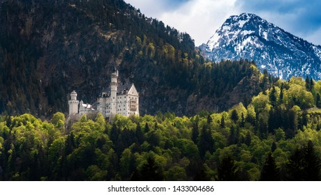 The famous Neuschwanstein castle with snow mountain background, Germany