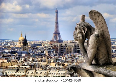 Famous Notre Dame gargoyle overlooking the Paris cityscape with Eiffel Tower  - Shutterstock ID 1044247060