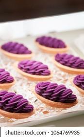 Famous Okinawa Beni Imo tart or sweet purple yam tart, beautiful arrange on tray