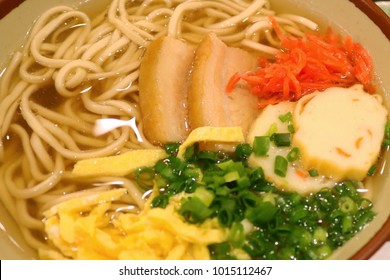 The famous Okinawa Soba is a type of noodle soup produced in Okinawa Prefecture that topping with streaky oil pork meat, fish ball, fried eggs and red ginger served on a noodle bowl.