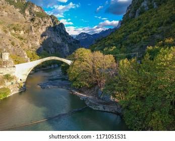 The famous old stoned bridge of Konitsa over Aoos river. Tymfi mount, Zagori, Epirus, Greece, Europe