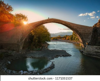 The famous old stoned bridge of Konitsa over Aoos river. Tymfi mount, Zagori, Epirus, Greece, Europe