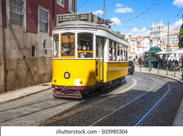 Famous old yellow tram on street of Lisbon/Lisboa.