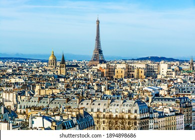Famous Paris skyline with the Eiffel Tower as seen from the top of the Notre Dame Cathedral. Cityscape of Paris, France