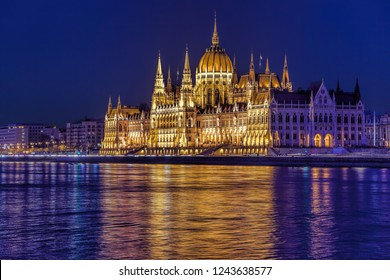 Famous Parliament building of Budapest above Danube river in Hungary at night.