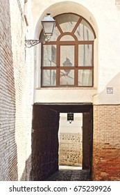 Famous passageway with dwellings or dependencies on it, that forms part of the series of medieval sheds of  streets of Toledo, with window in  ancient building of this city, a world heritage site,