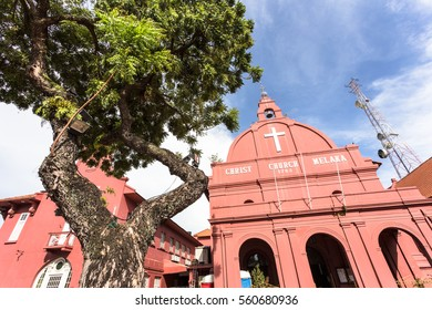 The famous pink Christ church in Dutch square in the colonial old town of Melaka (or Malacca) in Malaysia, Southeast Asia.