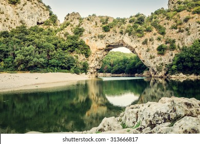 Famous Pont d'Arc in the Ardeche, France. Toned image.