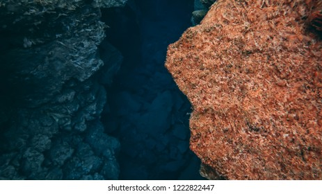 Famous popular crack fissure Silfra between two tectonic plates north american and eurasian crystal clear glacier cold blue water