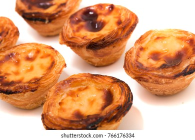 Famous Portuguese egg pastry tart called 'Pastel de Belem' isolated on white background.