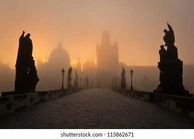 Famous Prague Charles bridge in misty morning
