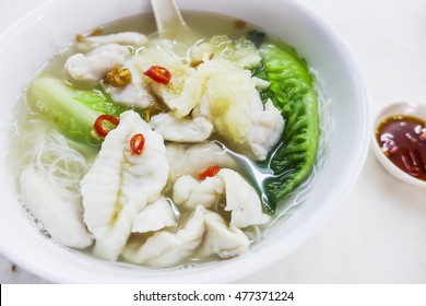 Famous pulau pangkor seafood soup noodle situated in the northwest of malaysia / Food background / Made from fresh mackerel fish paste, grouper fish meat and fish maw