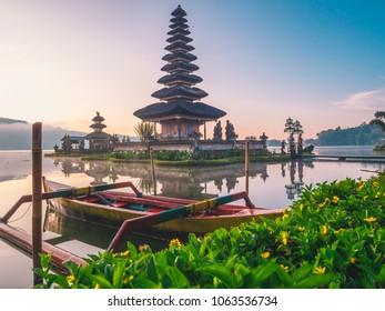 Famous Pura Ulun Danu Bratan temple on Beratan lake in Bali island, Indonesia at foggy sunrise. Iconic image of Bali and southeast asia. Balinese culture and religion concept. Asia Travel Concept.