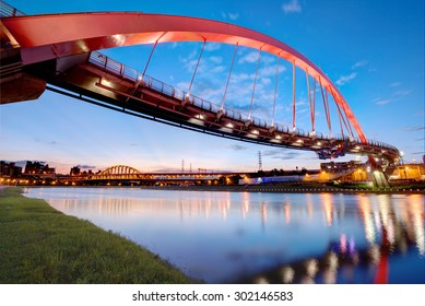 The famous Rainbow Bridge over Keelung River with reflections on smooth water at dusk in Taipei, Taiwan, Asia ~ A romantic landmark of Taipei, the capital city of Taiwan, under beautiful evening sky