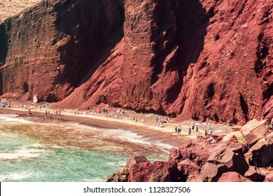 The famous Red Beach in Santorini, Greece with clouds and blue sky
