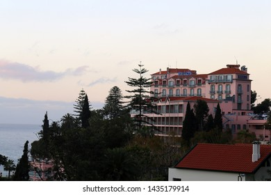 Famous Reid's Palace hotel and restaurant during sunset. Funchal, Madeira, Portugal photographed March 2019. In here you can get famous 5 O'Clock tea and more. Beautiful, colorful landscape photo.