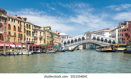 Famous Rialto Bridge over the Grand Canal in Venice, Italy. Rialto Bridge (Ponte di Rialto) is one of the main travel attractions of Venice. Historical architecture and landscape of Venice.