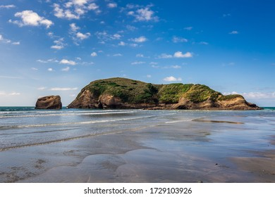 Famous rock formations on the Wharariki beach in National Park. Nelson, South Island, New Zealand.