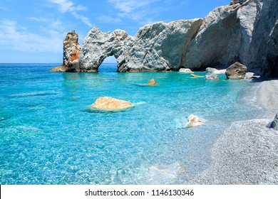 The famous rock with a hole in Lalaria Beach, Skiathos