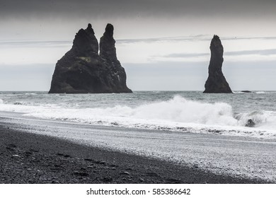 Famous rocks of Reynisdrangar next to a volcanic black sand beach near the town of Vik, southern Iceland