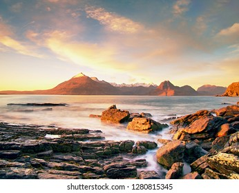 The famous rocky bay of Elgol on the Isle of Skye, Scotland.  The Cuillins  mountain in the background. Photographed at sunset.