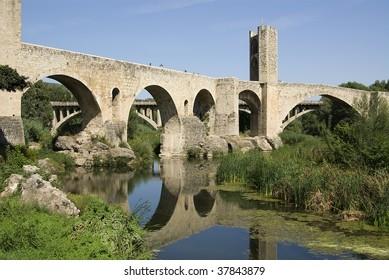 Famous romanic bridge of Besal? town, Spain