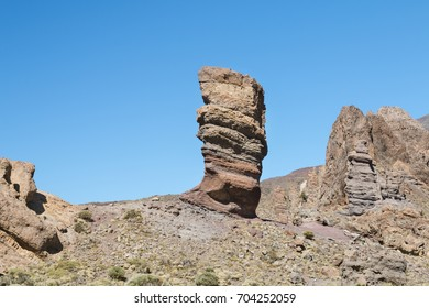 The famous Roque Cinchado in Tenerife, Spain with other rock formations in the background.